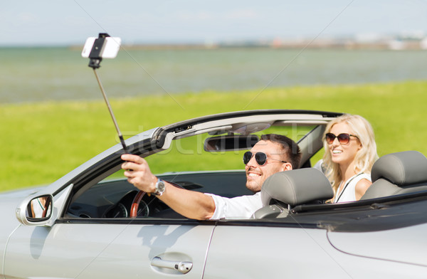 happy couple in car taking selfie with smartphone Stock photo © dolgachov