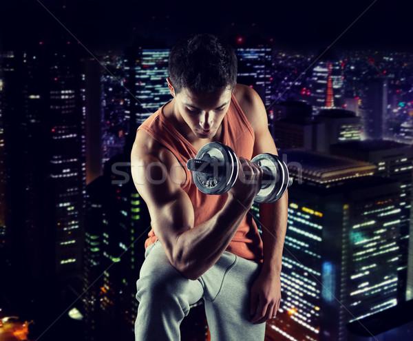 молодым человеком бицепс спорт подготовки Сток-фото © dolgachov