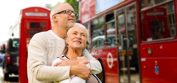 happy senior couple on london street in england Stock photo © dolgachov