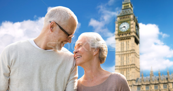 happy senior couple over big ben tower in london Stock photo © dolgachov