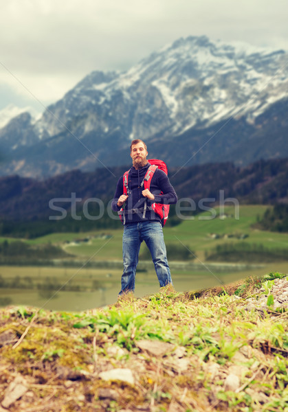 tourist with beard and backpack Stock photo © dolgachov