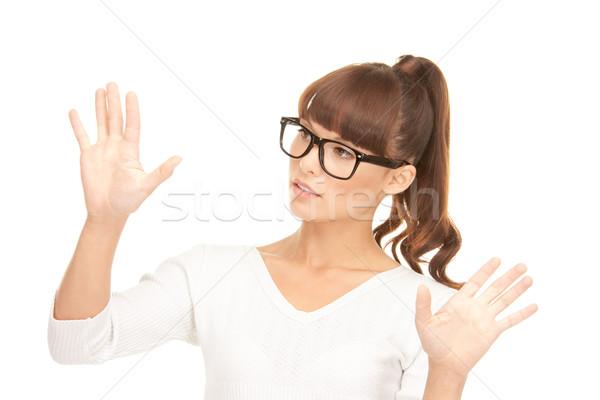 Femme d'affaires travail quelque chose imaginaire photos affaires Photo stock © dolgachov