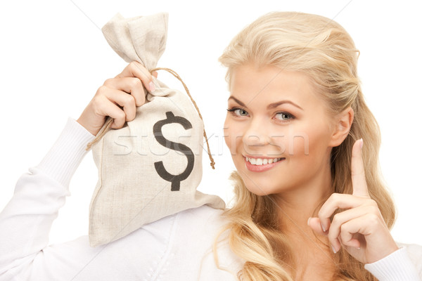 woman with dollar signed bag Stock photo © dolgachov