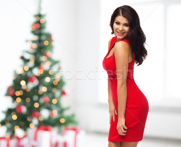 sexy woman in red dress over christmas tree Stock photo © dolgachov