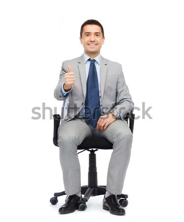 happy businessman  sitting in office chair Stock photo © dolgachov