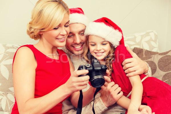 Család mikulás segítő sapkák néz karácsony Stock fotó © dolgachov