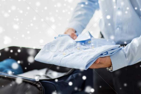 Geschäftsmann Verpackung Kleidung Reise Tasche Geschäftsreise Stock foto © dolgachov