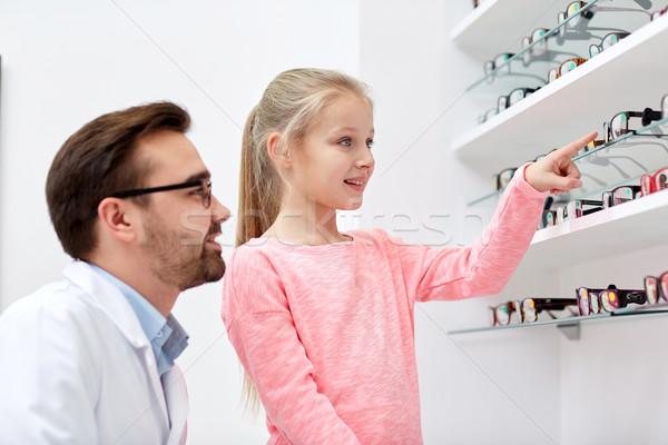 Optikus lány választ szemüveg optika bolt Stock fotó © dolgachov