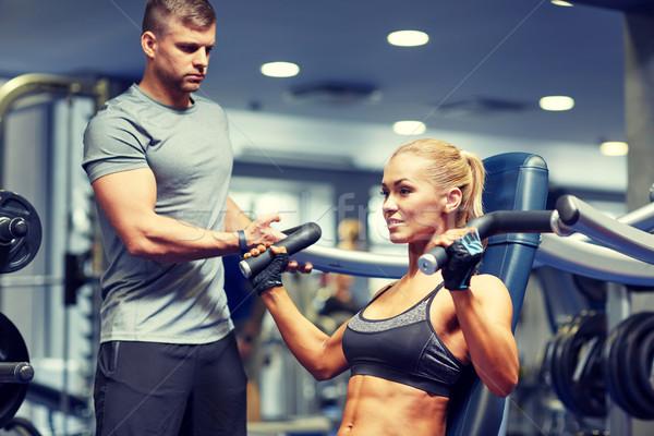 Adam kadın kaslar spor salonu makine spor Stok fotoğraf © dolgachov