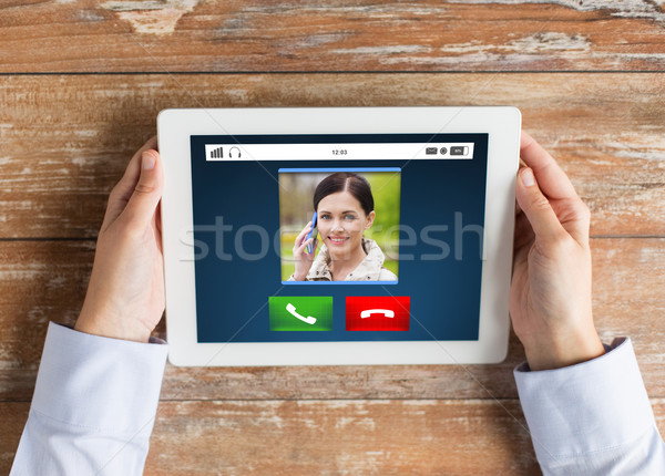 close up of hands with incoming call on tablet pc Stock photo © dolgachov