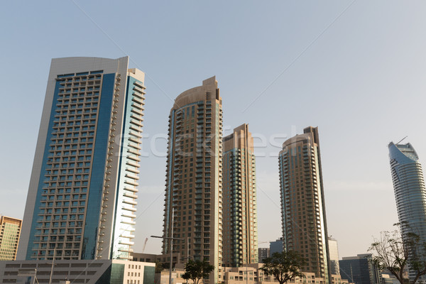 Dubai city business district with skyscrapers Stock photo © dolgachov