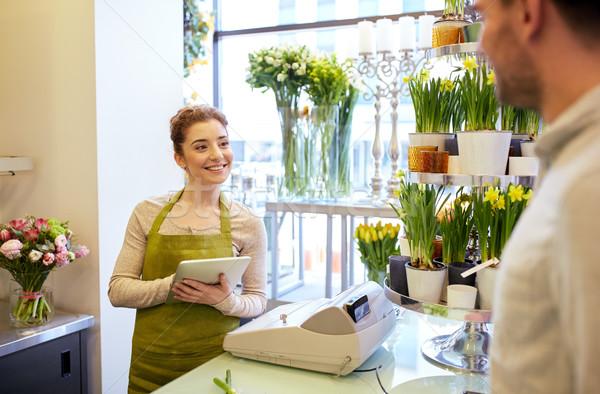 Fleuriste femme homme ordre Photo stock © dolgachov