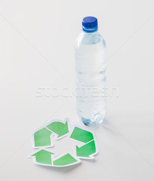 close up of plastic bottle and recycling symbol Stock photo © dolgachov