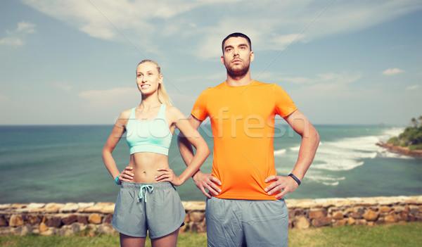 happy couple exercising over sea or beach Stock photo © dolgachov