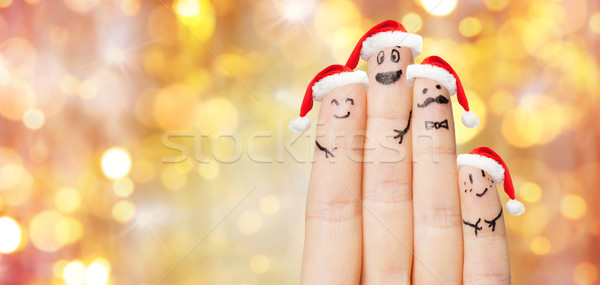 close up of hand with four fingers in santa hats Stock photo © dolgachov