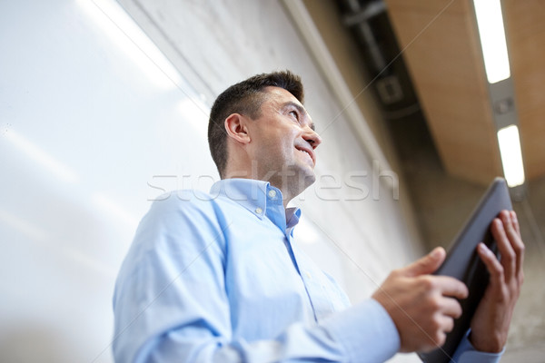 teacher or lector with tablet pc at lecture Stock photo © dolgachov