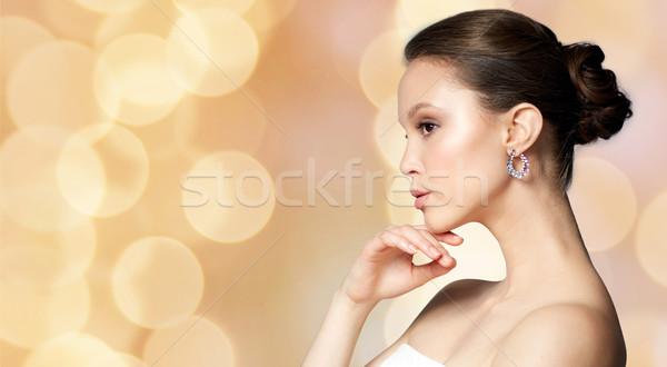 Bela mulher brinco férias luzes beleza jóias Foto stock © dolgachov