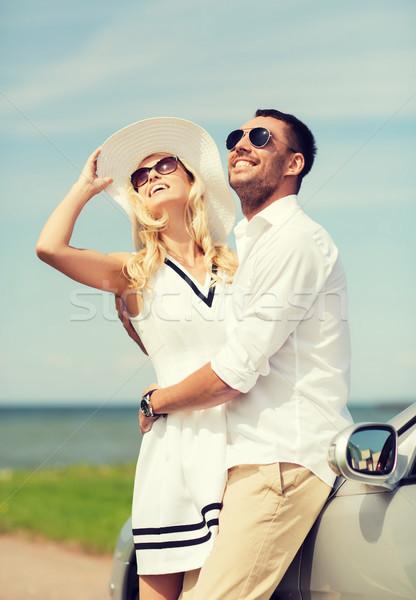 happy man and woman hugging near car at sea Stock photo © dolgachov