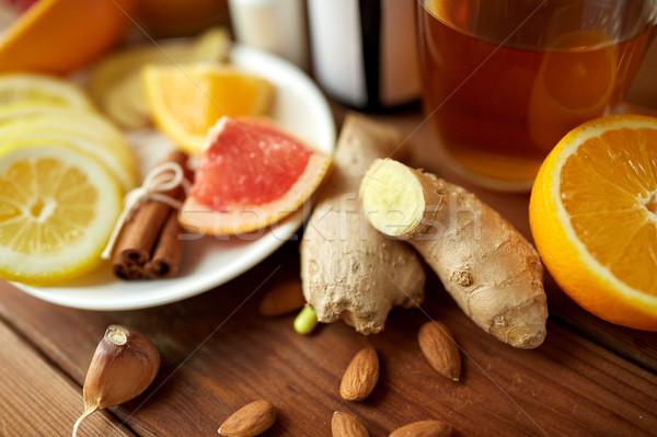 ginger, citrus fruits, tea or honey on wood Stock photo © dolgachov