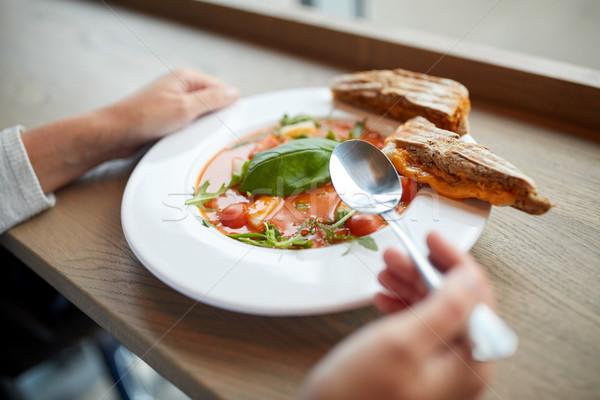 woman eating gazpacho soup at restaurant Stock photo © dolgachov