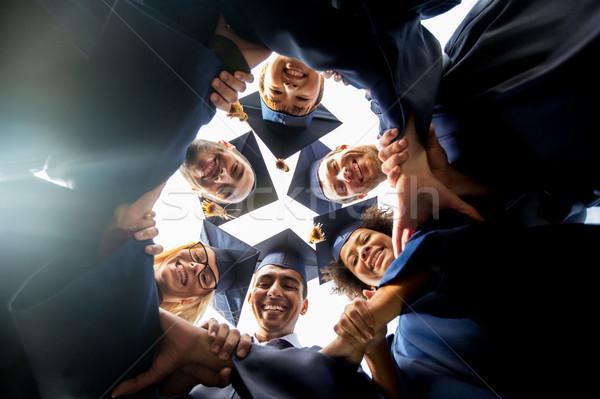 Feliz estudiantes solteros educación graduación unidad Foto stock © dolgachov