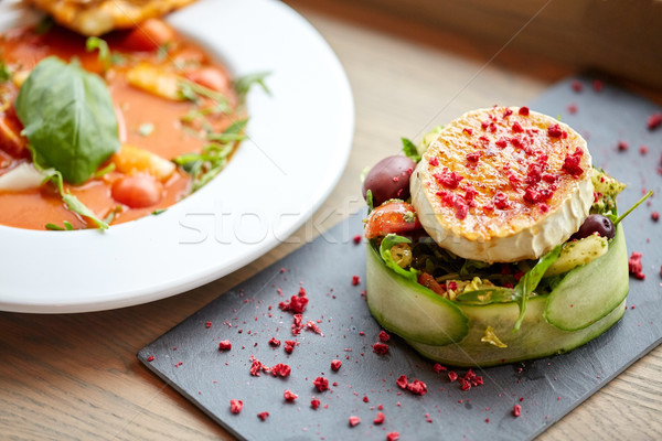 goat cheese salad and gazpacho soup at restaurant Stock photo © dolgachov