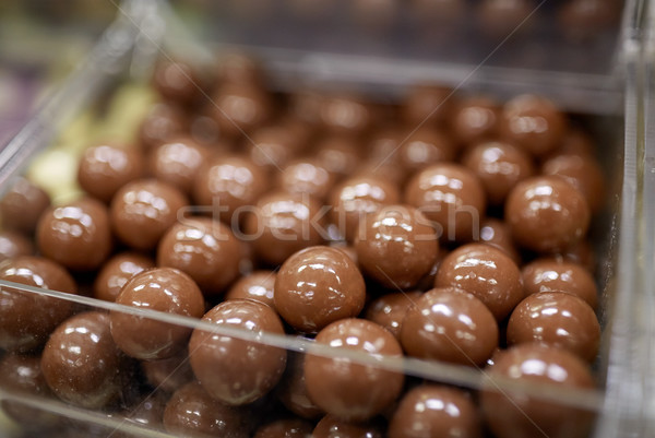 close up of chocolate dragee candies in box Stock photo © dolgachov