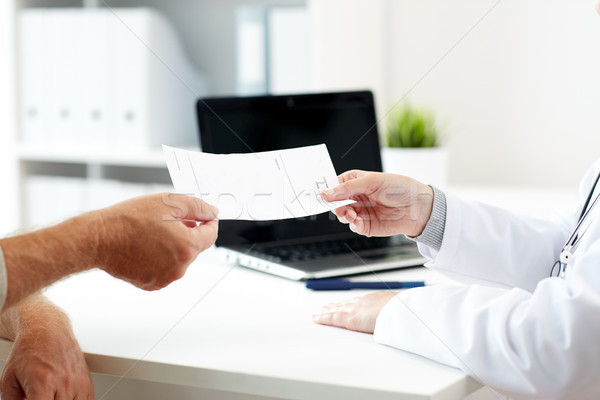 doctor giving prescription to patient at hospital Stock photo © dolgachov