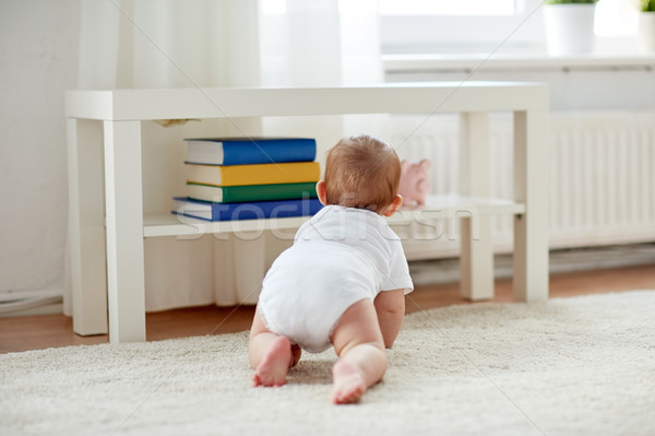 little baby in diaper crawling on floor at home Stock photo © dolgachov