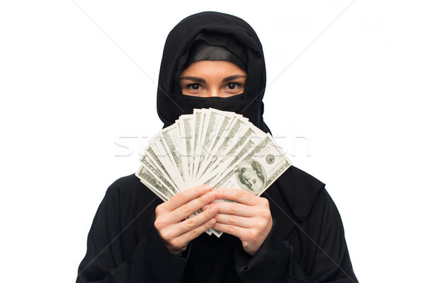 muslim woman in hijab with money over white Stock photo © dolgachov