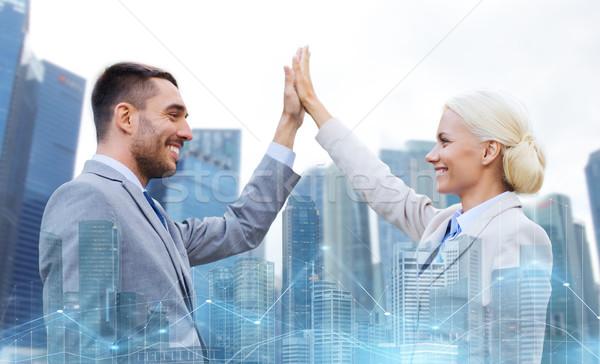 Zakenman zakenvrouw high five business Stockfoto © dolgachov