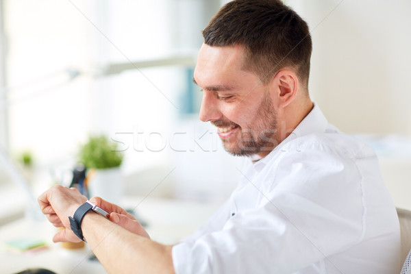 close up of businessman with smartwatch at office Stock photo © dolgachov