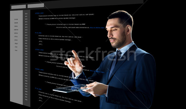 businessman with tablet pc and virtual coding Stock photo © dolgachov