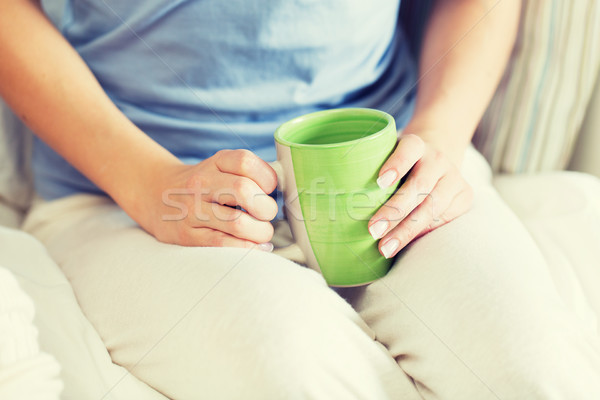 close up of young woman with tea cup Stock photo © dolgachov