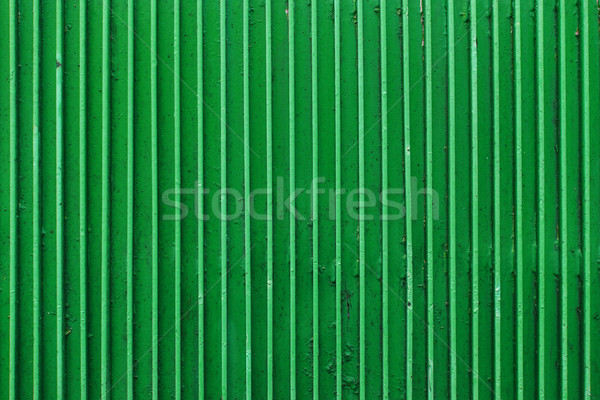 old green painted metal ribbed surface Stock photo © dolgachov