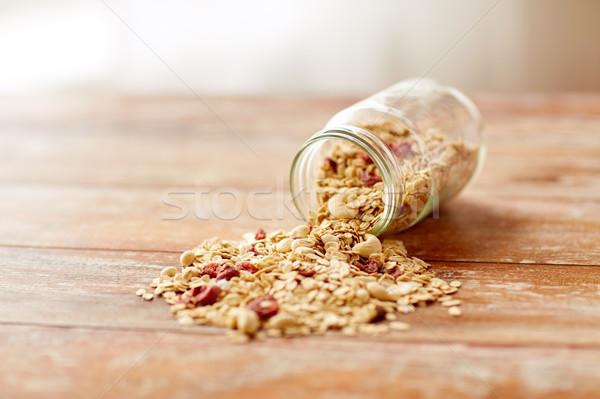 jar with granola or muesli poured on table Stock photo © dolgachov