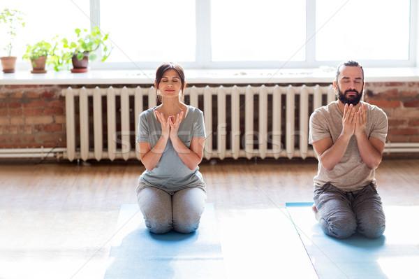 man and woman meditating at yoga studio Stock photo © dolgachov