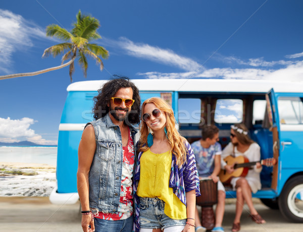 Stock photo: happy hippie couples and minivan on beach