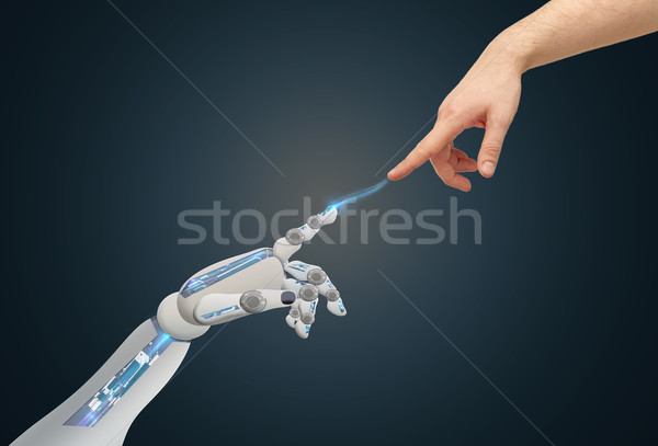 human and robot hands reaching to each other Stock photo © dolgachov