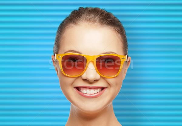 happy teenage girl or woman face in shades Stock photo © dolgachov