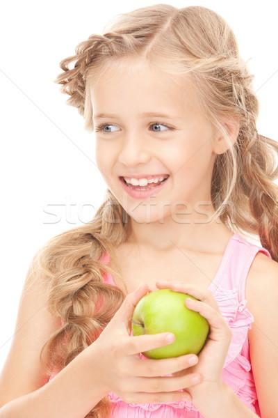 little girl with green apple Stock photo © dolgachov