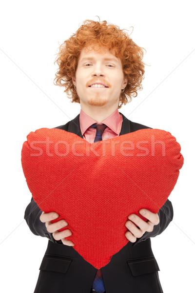 Bel homme rouge oreiller photos homme heureux Photo stock © dolgachov