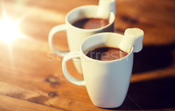 cups of hot chocolate with marshmallow on wood Stock photo © dolgachov