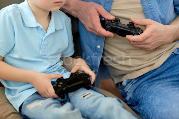 close up of father and son playing video game Stock photo © dolgachov