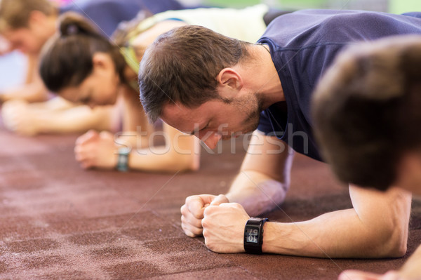 man with heart-rate tracker exercising in gym Stock photo © dolgachov