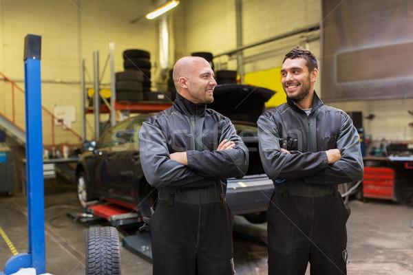 auto mechanics or tire changers at car shop Stock photo © dolgachov