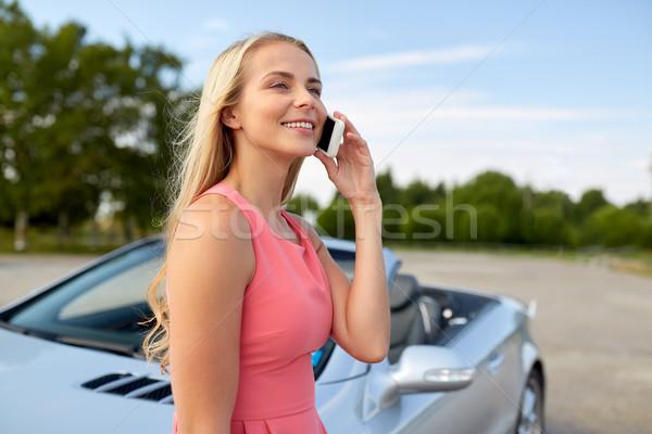 woman calling on smartphone at convertible car Stock photo © dolgachov