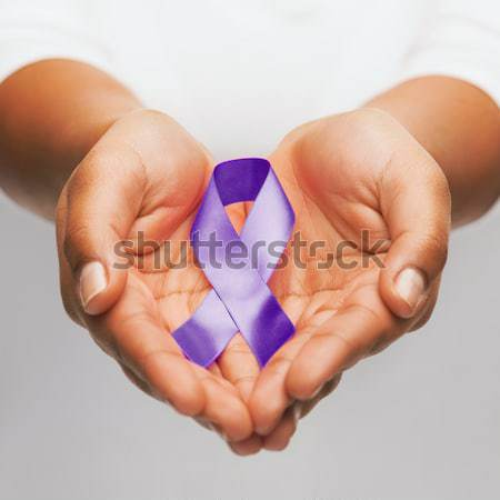 female hands holding gay pride awareness ribbon Stock photo © dolgachov