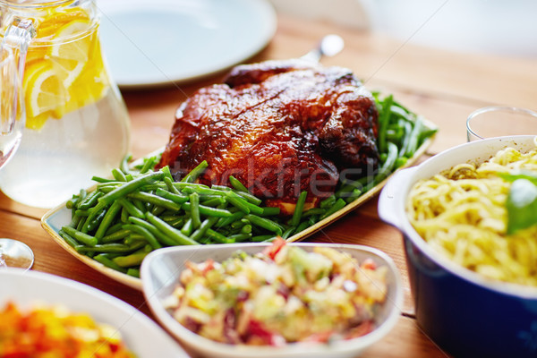roast chicken with garnish of green beans on table Stock photo © dolgachov
