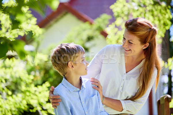 happy mother and son at summer garden Stock photo © dolgachov